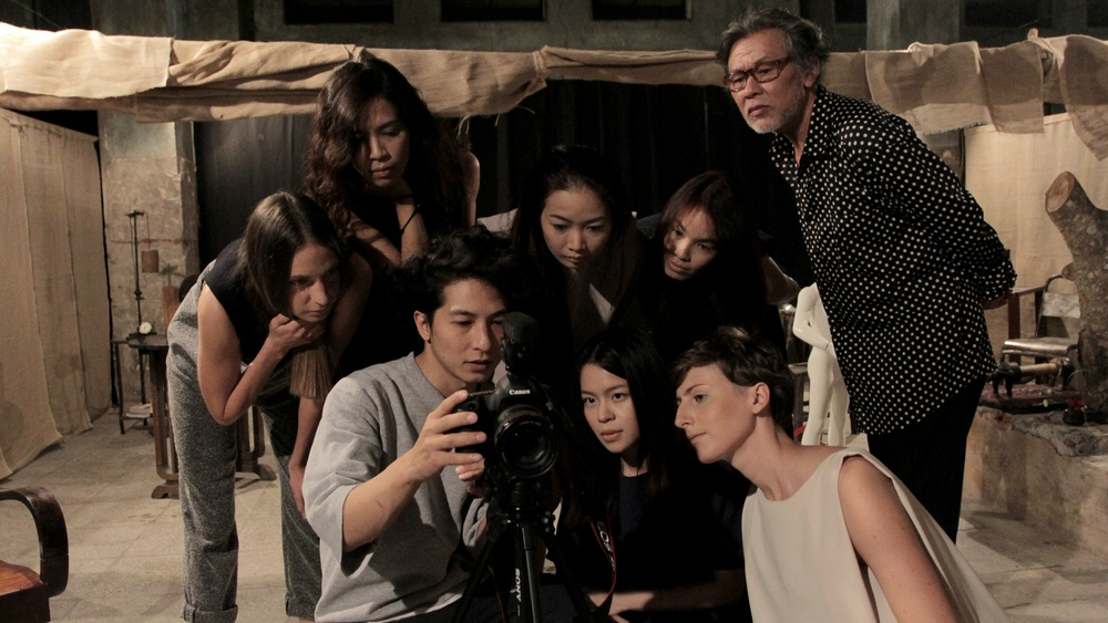 Designer Chuong Pham reviewing images with Kaarem models